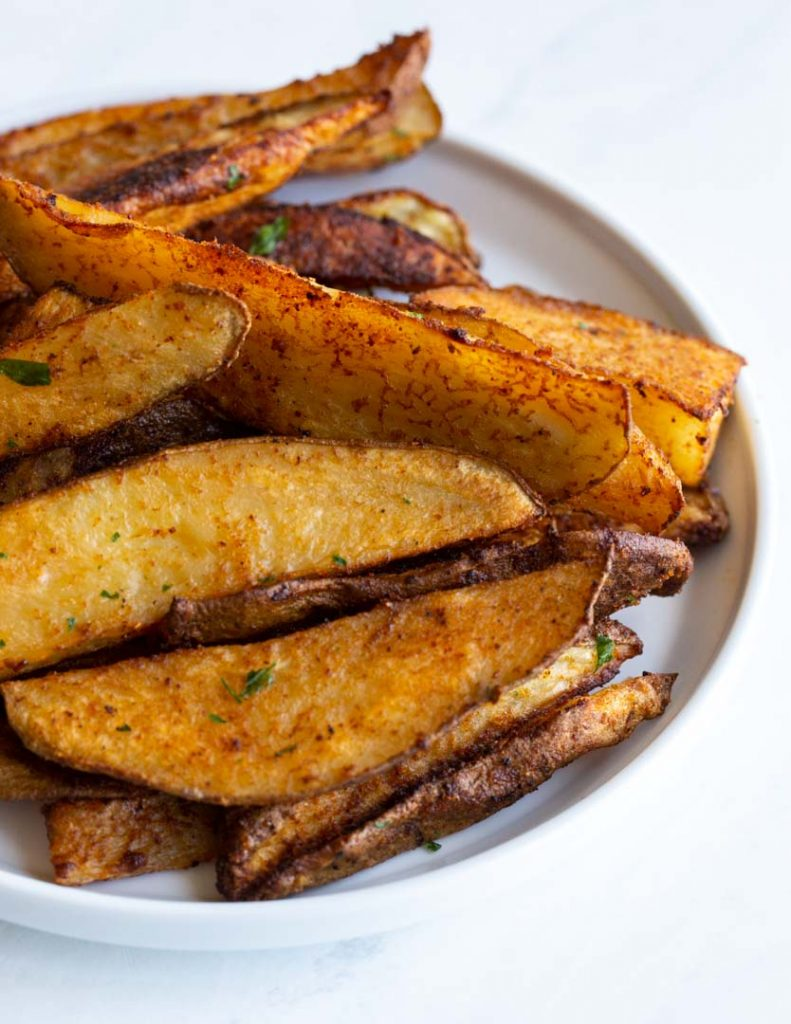 seasoned potato wedges on a plate