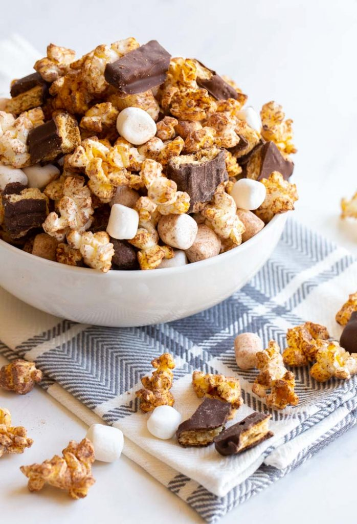 s'mores popcorn with mini marshmallows and chocolate grahams in a bowl