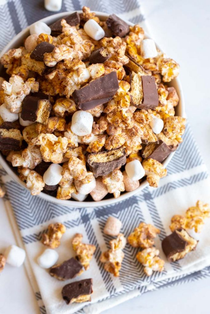 s'mores popcorn with marshmallows and chocolate in a bowl