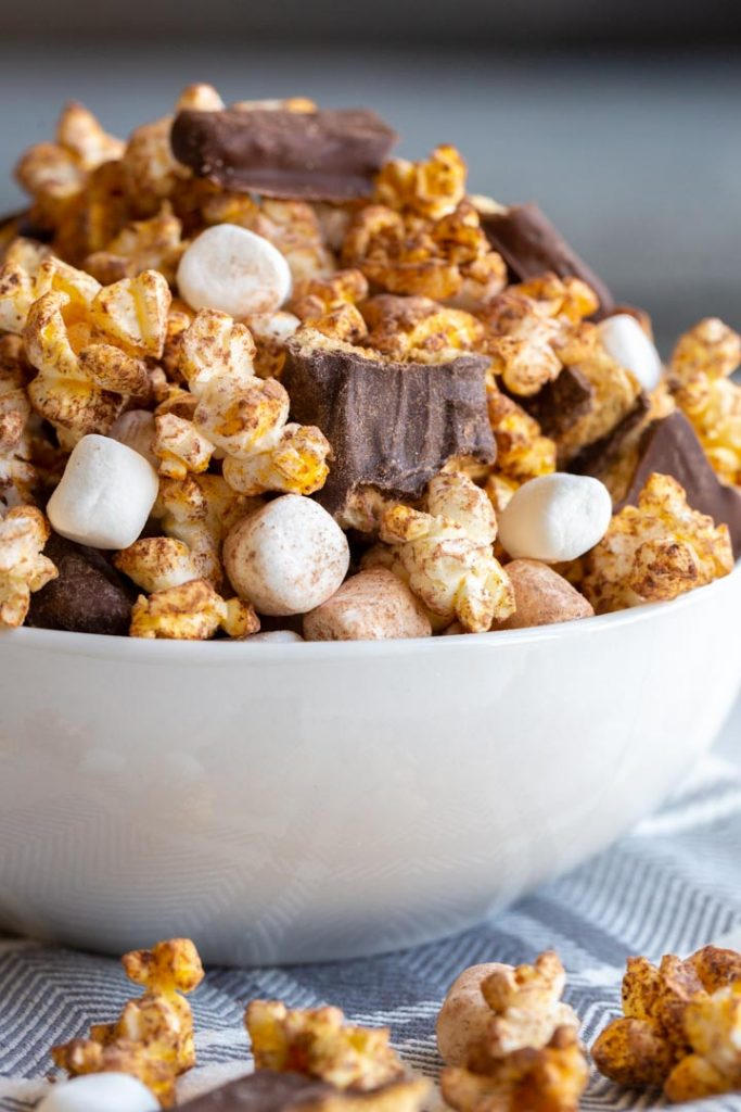 s'mores popcorn in a white bowl