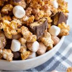 S'mores popcorn is a fun twist on traditional popcorn with marshmallows, chocolate covered grahams and a dusting of cocoa. Perfect for snacking on summer movie nights!