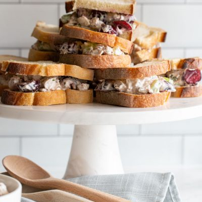 cherry chicken salad sandwiches on a stand
