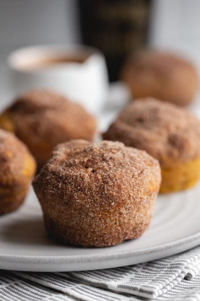 close up of a pumpkin muffin coated in cinnamon sugar