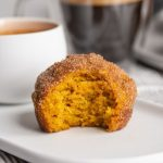 Super easy pumpkin muffins baked and rolled in cinnamon sugar. Perfectly paired with a morning coffee, they're soft, dense, and bursting with flavor!