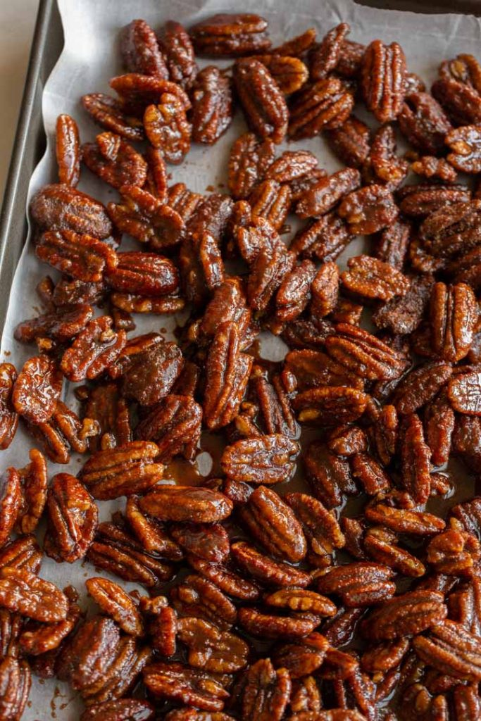 spicy candied pecans drying on parchment