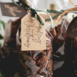 spicy candied pecans in cellophane bags with ribbon and a gift tag