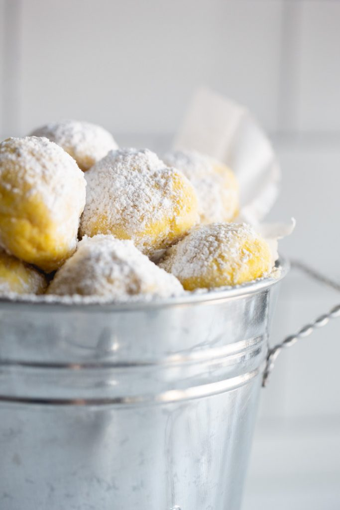 lemon snowball cookies in a tin