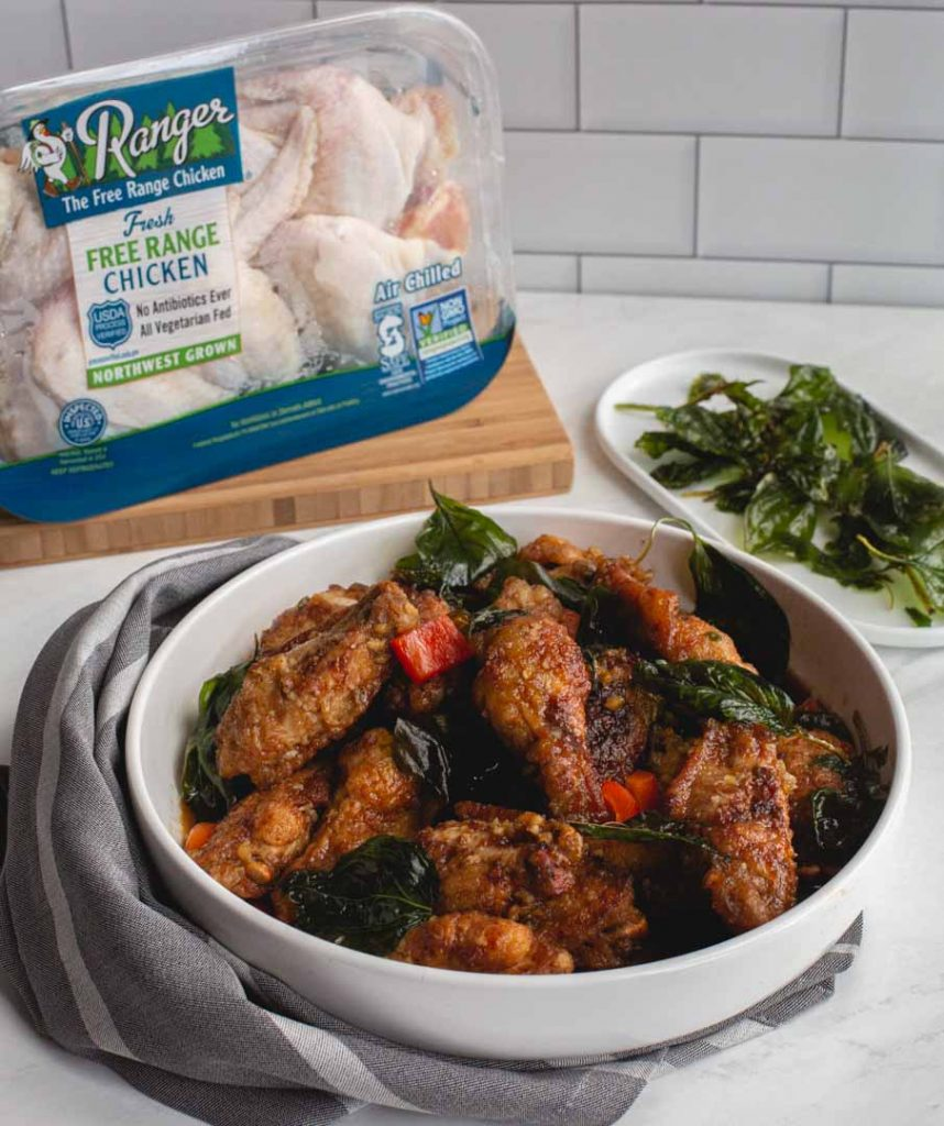 crispy garlic chicken wings with a package of chicken in the background