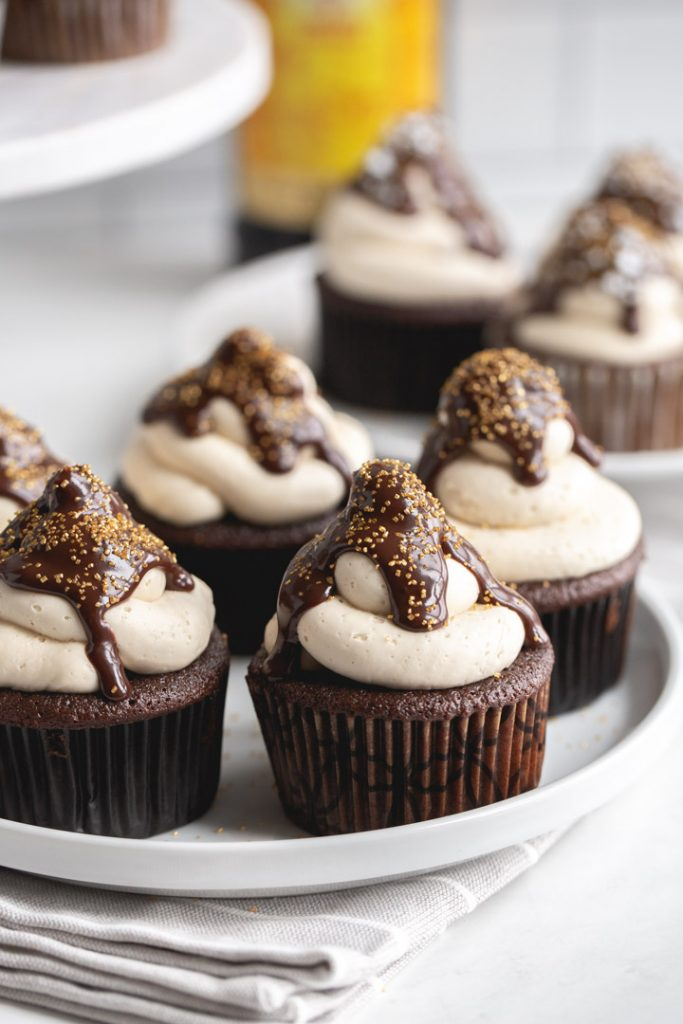 kahlua cupcakes on a plate with frosting and chocolate ganache and sprinkles