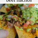 These restaurant style beef nachos are a great way to celebrate all trash fires in life: with chips, seasoned beef, cheese, and more, baked easily in cast iron or on a sheet pan in the oven. Top it with a spicy homemade green fire sauce.