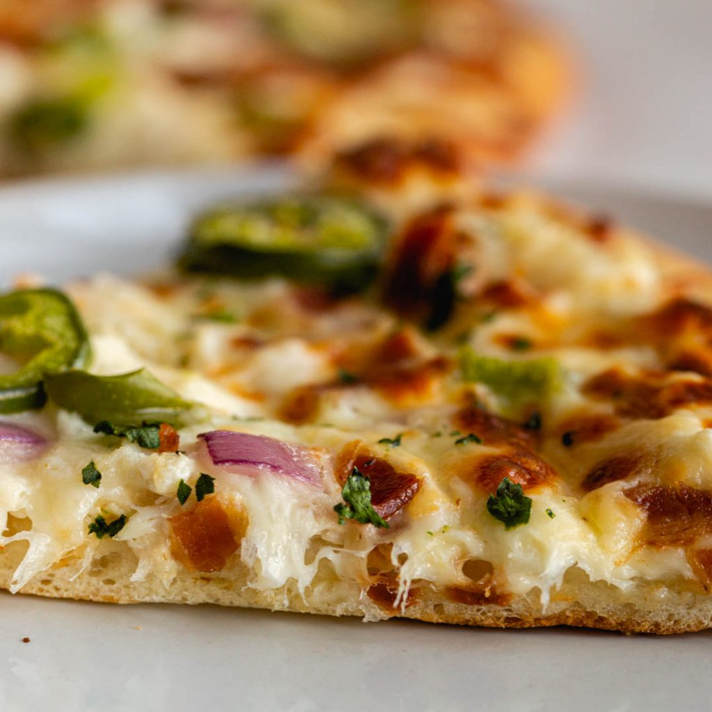 side view of a slice of crab pizza