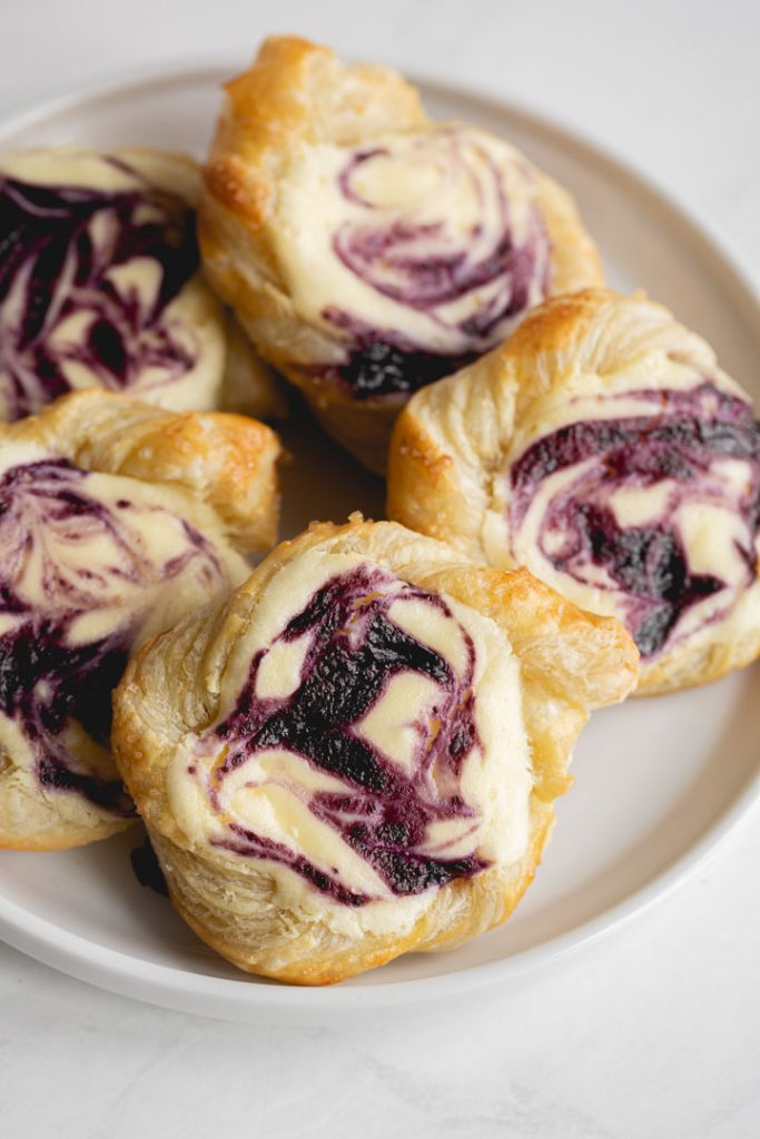 blueberry danishes made with puff pastry swirled with cream cheese and blueberry sauce