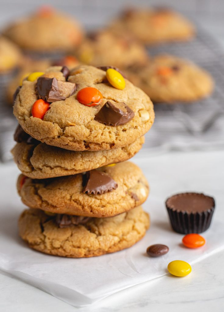 a stack of peanut butter cup cookies with peanut butter candies