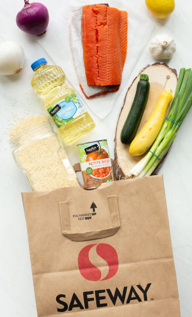 safeway bag laying on its side with its ingredients spilled out