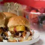 bbq chicken sliders with pineapple and coleslaw on a brioche bun