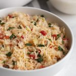 basmati rice pilaf in a bowl garnished with parsley