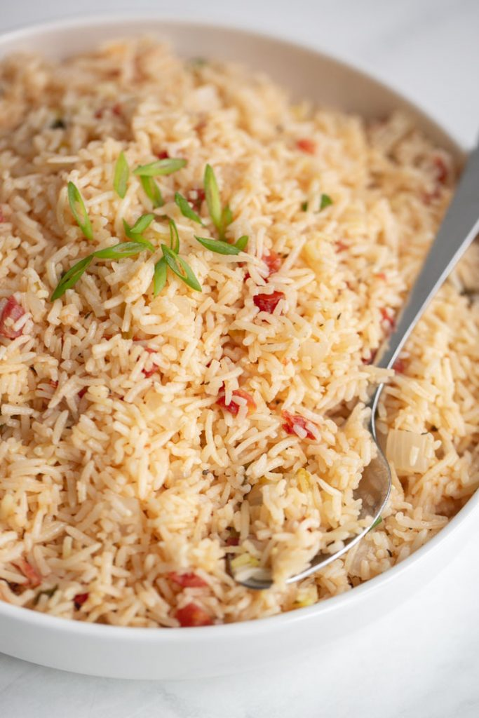 basmati rice pilaf in a bowl garnished with scallions