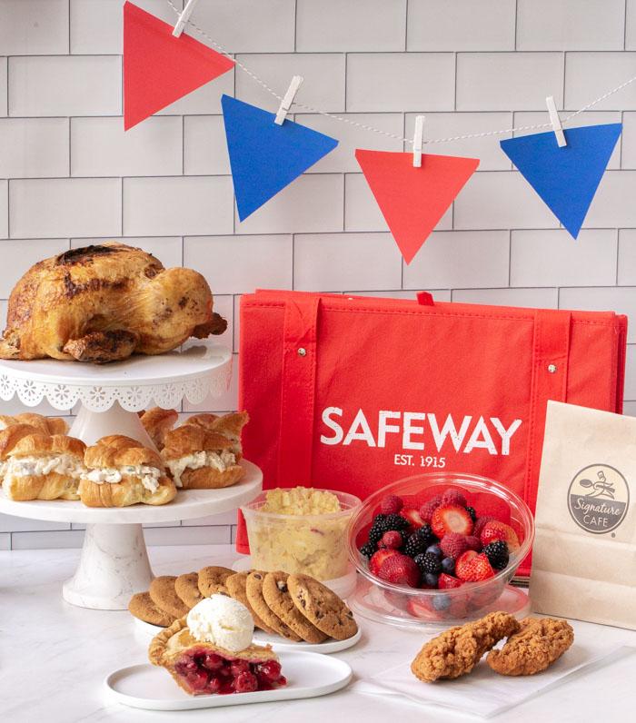 cherry pie with ice cream, fried chicken, fresh fruit, potato salad, chicken and chicken salad sandwiches with a Safeway bag
