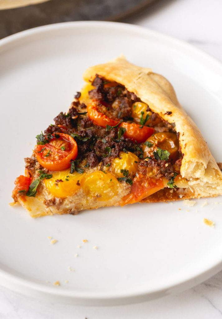 slice of impossible italian sausage and tomato galette on a plate